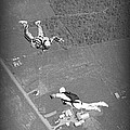 Freefalling Nova Scotia Skydivers In Stewiacke by John Malone