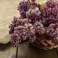 Fresh Lilacs In Brown Basket by Jaroslaw Blaminsky