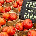 Fresh Tomatoes In Baskets At Farmers Market by Teri Virbickis