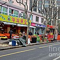 Fruit Shop And Street Scene Shanghai China by Imran Ahmed