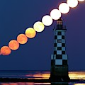 Full Moon Rising Over Lighthouse by Laurent Laveder