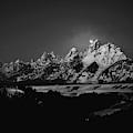 Full Moon Sets In The Teton Mountain Range by Raymond Salani Iii