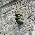 Gargoyle On The Side Of Castle Doune Scotland by Lesley Nolan