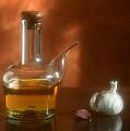 Garlic And Olive Oil. by Juan Carlos Ferro Duque