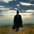 Gentleman In Top Hat Walking In Field by Jill Battaglia
