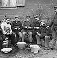 Germans Peeling Potatoes by Underwood Archives