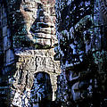 Gigantic Face Statues At Khmer Temple Angkor Wat Ruins Cambodi by Ryan Fox
