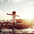 Girl Dancing On Beach At Sunset Sun Rays by Dianne Avery Photography