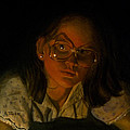 Girl In Glasses In Candlelight by Robert Tracy