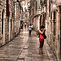 Girl In Red In The White Streets Of Dubrovnik by Weston Westmoreland