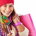 Girl Lick Sweets And Holding Pink Bag by Anna Om