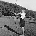 Girl Scout With Bow And Arrow by Underwood Archives