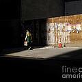 Girl Walking Into Shadow - New York City Street Scene by Miriam Danar