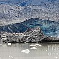 Glacier Tongue Calfing Icebergs Into Glacial Lake by Stephan Pietzko
