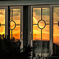 Glass Doors Aglow by E Faithe Lester