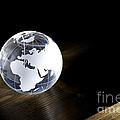 Glass Globe On Wooden Floor by Simon Bratt Photography LRPS