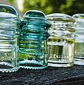 Glass Insulator Row by Deborah Smolinske