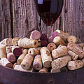 Glass Of Wine With Corks by Garry Gay