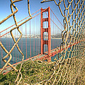 Golden Gate through the fence by Scott Norris