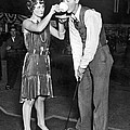 Golf Player Gets Coffee Boost by Underwood Archives