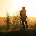 Golfer At Sunset by Steve Ball