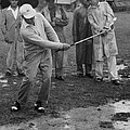 Golfer Playing In The Rain by Underwood Archives