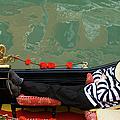 Gondolier Resting In Gondola by Brent Winebrenner