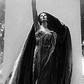 Gothic Surreal Haunting Female Cemetery Mourner Figure Black Caped Woman In Front Of Gravestone by Kathy Fornal