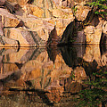 Granite Cliffs And Reflections In A Quarry Lake by Greg Matchick