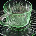 Green Glass Cup And Saucer by Nina Silver