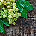Green Grapes On A Rustic Wooden Table by Ken Biggs
