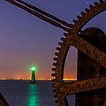 Green Lighthouse by Semmick Photo