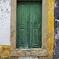 Green Wood Door With Hand Carved Stone Against A Texured Wall In The Medieval Village Of Obidos by David Letts
