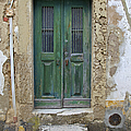 Green Wood Door With Hand Carved Stone In The Medieval Village Of Obidos by David Letts
