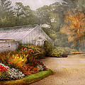 Greenhouse -  Early Morning And Tending To The Flowers by Mike Savad
