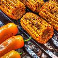 Grilling Corn And Peppers by Roger Passman