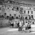 Groups Of Tourists And Guides In The Main Arena Of The Old Roman Colloseum At El Jem Tunisia by Joe Fox