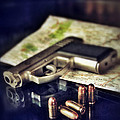 Gun With Bullets And Map by Jill Battaglia