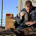 Gunners Mate Sorts Ammunition by Stocktrek Images