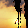 Hand Holding Rudraksha Beads by Tim Gainey