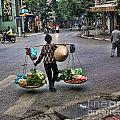 Hanoi Street Life II by Chuck Kuhn