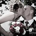 Happy Bride And Groom Kissing by Michal Bednarek