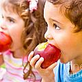 Happy Children Eating Apple by Anna Om