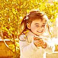 Happy Little Girl In Autumn Park by Anna Om
