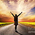 Happy Woman Standing On Long Road At Sunset by Michal Bednarek