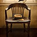 Hawk And Fedora On Chair by Jill Battaglia