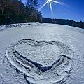 Heart Outlined On Snow On Topw Of Frozen Lake by Alex Grichenko