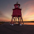 Herd Groyne Lighthouse On The Water S by John Short