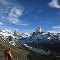 Hiker Admiring Cerro Torre And Fitzroy by Colin Monteath