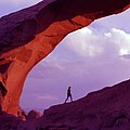 Hiker Beneath Arch by Steve Ohlsen